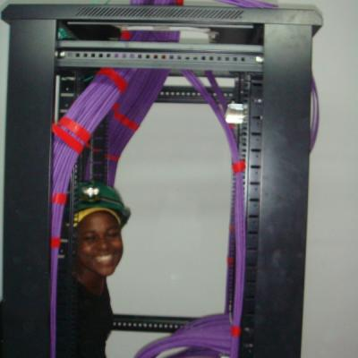 Suzan in one of meny comincation racks at Total E&P Uganda